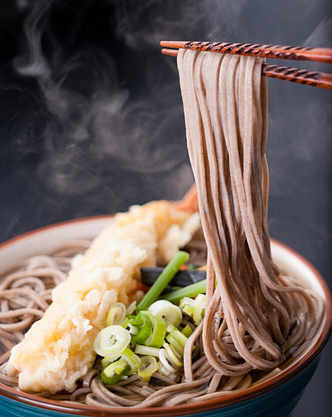 photo of ramen noodles being raised using chopsticks | types of Noodles in Japan