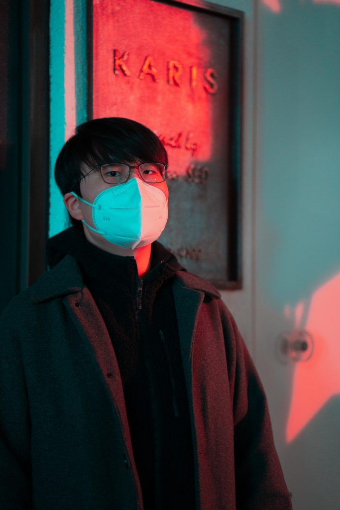Japanese man with eye glasses wearing a face mask | Why Wearing Mask is Popular in Japan